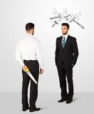 Businessman hiding a weapon Royalty Free Stock Image
