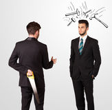 Businessman hiding a weapon Royalty Free Stock Photography