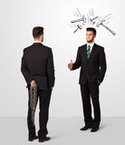 Businessman hiding a weapon Royalty Free Stock Images
