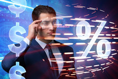 The businessman in high interest rate concept. Businessman in high interest rate concept stock photography