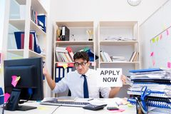 The businessman hiring new employees to cope with increased workload. Businessman hiring new employees to cope with increased workload Royalty Free Stock Image