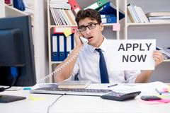 The businessman hiring new employees to cope with increased workload. Businessman hiring new employees to cope with increased workload Royalty Free Stock Photos