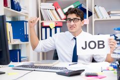 The businessman hiring new employees to cope with increased workload. Businessman hiring new employees to cope with increased workload Stock Photos