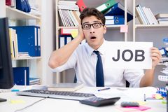 The businessman hiring new employees to cope with increased workload. Businessman hiring new employees to cope with increased workload Stock Photo