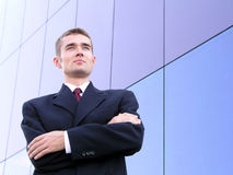 Businessman With His Arms Crossed. Standing Outside a Modern Office Building Royalty Free Stock Photos