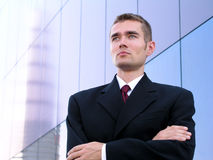 Businessman With His Arms Crossed. Standing Outside a Modern Office Building Stock Photos