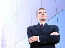 Businessman With His Arms Crossed. Standing Outside a Modern Office Building Stock Photo