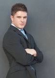 Businessman with his arms folded Stock Photo