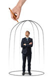 Businessman with his arms folded standing in a hand drawn cage isolated on white background. Business staff. Despair and misfortune. Office clothes. Helpless Royalty Free Stock Images