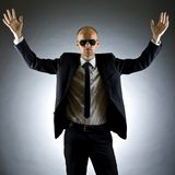 Businessman with his arms raised. One very happy energetic businessman with his arms raised Stock Photography