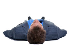 Businessman on his back Royalty Free Stock Images