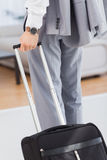 Businessman with his baggage Royalty Free Stock Photography