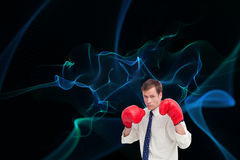 Businessman with his boxing gloves ready to fight Royalty Free Stock Photography