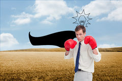 Businessman with his boxing gloves ready to fight Stock Photo