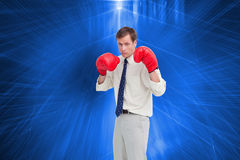 Businessman with his boxing gloves ready to fight Royalty Free Stock Photo