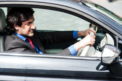 Businessman in his car Stock Image