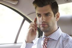 Businessman in his car Royalty Free Stock Image