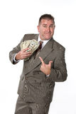 Businessman and his cash Royalty Free Stock Photos