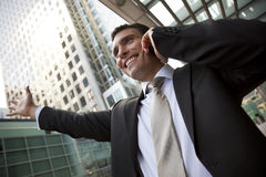 Businessman On His Cell In The City Stock Photo
