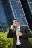 Businessman On His Cell Phone In A Modern City Royalty Free Stock Photography