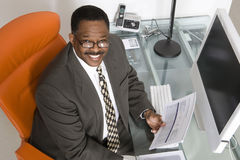 Businessman at His Desk Stock Photography