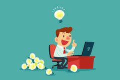 Businessman at his desk creating a lot of idea bulbs Stock Images