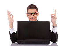 Businessman at his desk with a laptop Stock Photo