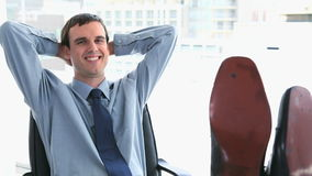 Businessman with his feet on his desk Stock Photography