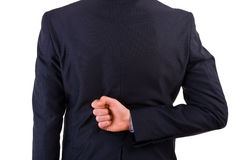 Businessman with his hand behind his back. Royalty Free Stock Image