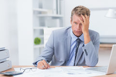 Businessman with his hand on his forehead Stock Image