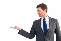 Businessman with his hand out Royalty Free Stock Photos