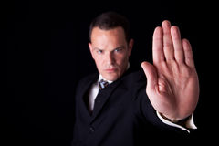 Businessman with his hand raised in signal to stop Stock Photography