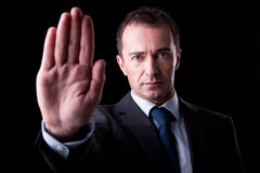 Businessman with his hand raised in signal to stop Royalty Free Stock Photo