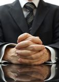 Businessman with his hands clasped.  Royalty Free Stock Photos
