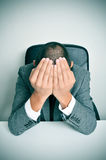 Businessman with his hands in his head Royalty Free Stock Image