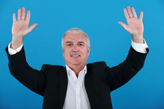 Businessman with his hands up Stock Images