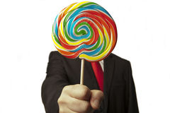 Businessman and his lollipop stock image