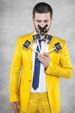 Businessman with his mouth sealed calling for help. Wearing a gold suit Royalty Free Stock Images