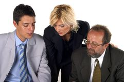Businessman With His Partner. Businessman working at his desk and talking to his business partner Royalty Free Stock Image