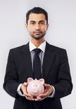 Businessman and His Piggy Bank Royalty Free Stock Photography
