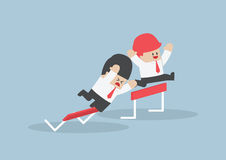 Businessman and his rival in hurdle race Royalty Free Stock Photo