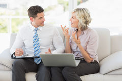 Businessman and his secretary with diary and laptop Stock Photos