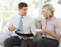 Businessman and his secretary  with diary and tea cup Royalty Free Stock Image