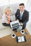 Businessman and his secretary with laptop and diary at home Royalty Free Stock Image