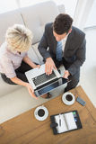 Businessman and his secretary with laptop and diary at home Royalty Free Stock Photo