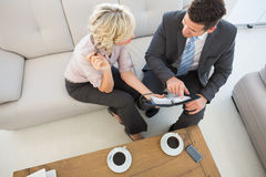 Businessman and his secretary  looking at diary at home Stock Photography