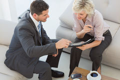 Businessman and his secretary  looking at diary at home Royalty Free Stock Images