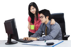 Businessman with his secretary working Stock Images