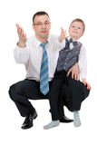 Businessman and his son pulled his hands Stock Photography