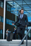 Businessman with his suitcase Royalty Free Stock Photo
